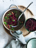 Lentil and speck soup with roast beetroot slaw