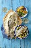 Salted sea bass, sea bream with ricotta, and seabream fillets with aromatic crumble