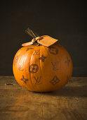 Pumpkin decorated with handbag brand logos
