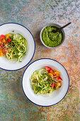 Zucchini pasta with rocket pesto and tomatoes