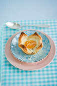 An egg in a toast bowl for breakfast