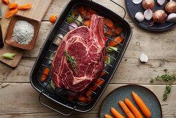 Prime rib roast in a roasting pan