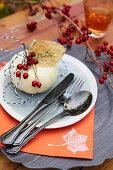 A DIY placecard made from an ornamental pumpkin