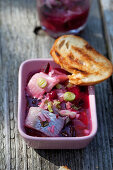 Pickled herring with beetroot and spring onions