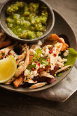 Chilaquiles with chicken served with tomatillo salsa (Mexico)