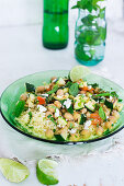 Couscous salad with chickpeas, grilled vegetables, limes, peppermint and feta cheese