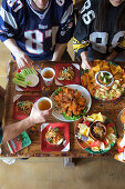Chicken wings, chili with corn chips, beer (USA)