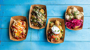 Various vegetarian dishes with fried potatoes to take away