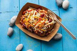 Fried potatoes with baked beans and cheese