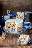 Sour cream walnut cake with prunes