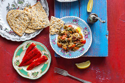 Middle eastern dip made of roasted aubergines, tomatoes, chillies, garlic, shallots, parsley, olive oil, lemon juice, cumin, salt and pepper