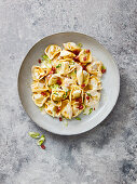 Tortelloni with bacon, spring onions and a creamy sauce