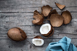 An arrangement of coconuts on a wooden surface