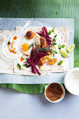Wraps with beet root and fish cakes