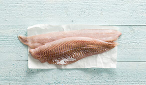 Cod fillets on a piece of paper