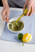 A filling made from parsley, garlic, lemon zest, anchovies, capers and breadcrumbs being made