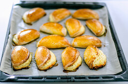Freshly baked quark pastries in a baking tray