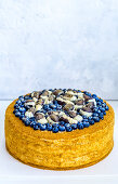 A blueberry cake decorated with chocolates