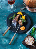 Fondue with beef, pumpkin, kale and salsa