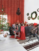 Table festively set for Christmas in red and black