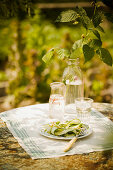 Zucchini and pea salad on a garden table