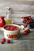 Wrinkle Solver cup of sweet soup: fruit soup with pomegranate seeds and berries