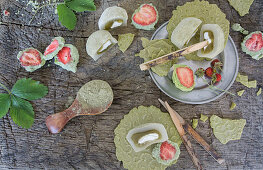 Strawberries in matcha chocolate, mochi and tea biscuits