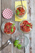 Baked tomatoes with basil on rice