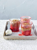 Cakes in glasses with strawberries and soya ice cream