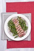 Marinated tuna fish on rocket salad