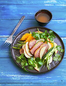 Apple and orange salad with roasted duck breast