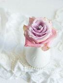 Romantic wedding decoration: ring nestled in a rose