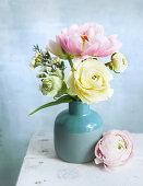 Bouquet of ranunculus in blue vase