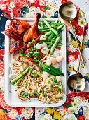 Shanghai noodles with barbecue duck and lychees