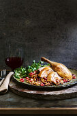 Roast duck with walnut and freekeh stuffing