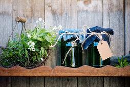 Jars of home-made sweet woodruff jelly on wooden shelf