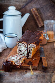 Chocolate brioche, cut on a wooden board