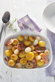 Fried potato and ham with white onions and rosemary