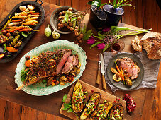 Roast leg of lamb and various side dishes