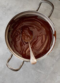 Melted chocolate couverture in a pot (top view)
