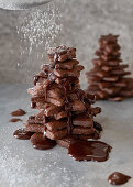 A chocolate biscuit tree sprinkled with powdered sugar