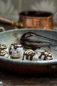 Handmade truffle pralines with chocolate sauce