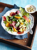 A winter salad with oranges, pistachios and chorizo chips