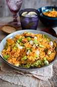A bowl of kimchi fried rice with pork and green onions
