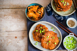 Korean pancakes with kimchi and spring onions