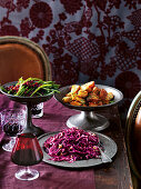 Marinated red cabbage slaw, the best roast potatoes and green bean with pomegranate