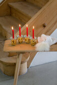 Alternative Advent wreath made from candles on mason jars containing biscuit numbers 1-4