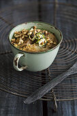 Bread soup with homemade zucchini chips and toasted almonds