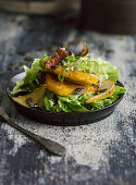 Beer battered pumpkin with endive and bacon salad