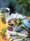 Black rice salad with ham, ginger beans and mango